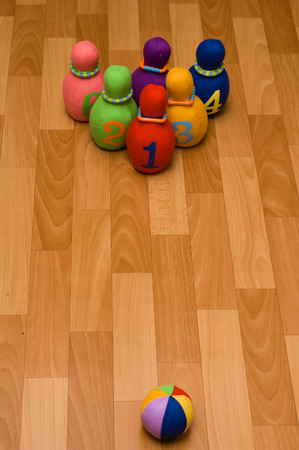 Toy bowling with rag skittles and bowl invites little players