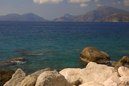 mediterranian: Mediterranian landscape with big stones in front and silhouette of mountains background