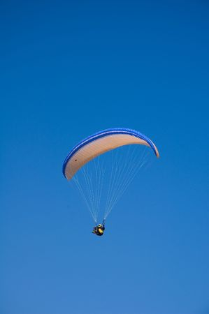 bottomless: Free flight of bold paraglider in the bottomless skies Stock Photo