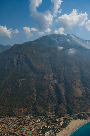 oludeniz: Aerial view on the Baba-Daga mountain and located near its slope Oludeniz town, Turkey