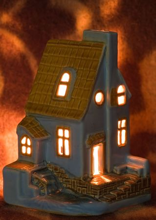 Photo of candy toy house with burning candy inside