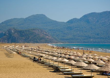 mediterranian: Line of sunshades on the beach sand at the endge of Mediterranian and Aegean Seas