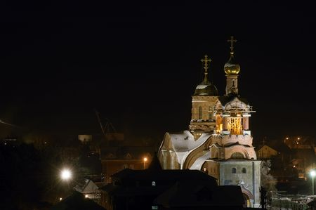 Night photo of old Ortodox Church building in a North Russia town photo