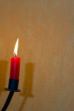 Photo of red burning candle shadows on the wall photo