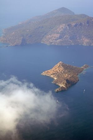 Aerial view on a small island in the Mediterranean sea Stock Photo