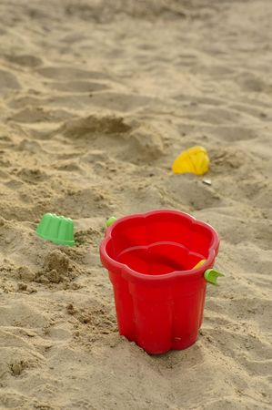 Photo of red toy bucket and a couple of toy mould at the send-box Stock Photo