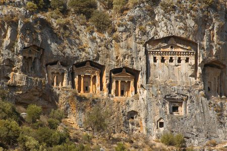 View on the tombs of ancient Likya kings carved out in the rock Stock Photo