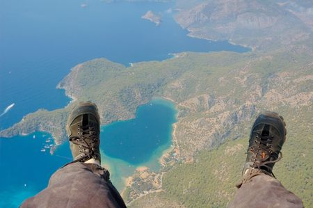 Paragliders look at the earth below his feet