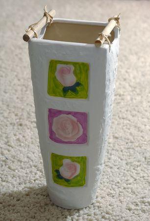 Photo of vase set on carpet in back-light photo