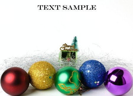 Photo of christmas balls with spangle and small gift box