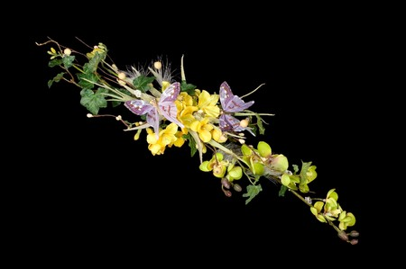 Photo of bouquet of artificial flowers isolated on black background Stock Photo