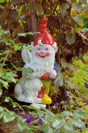Figures of dwarf and rabbit in the home garden