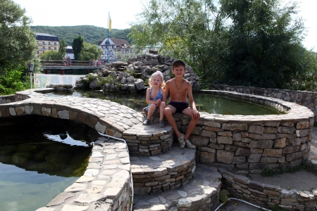 Brother and sister sunbathing in an artificial pond photo