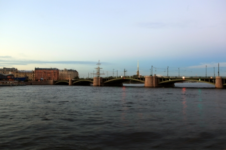 Exchange Bridge and the spire of the Peter and Paul Fortress in the late evening  St  Petersburg, Russia Stock Photo - 15575465