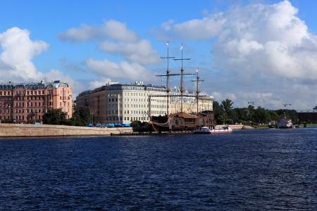 View of the embankment with Mytninskaya Exchange bridge  St  Petersburg, Russia  photo