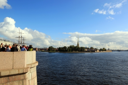 The tourists on the observation deck of the Exchange bridge admiring sights of St  Petersburg photo