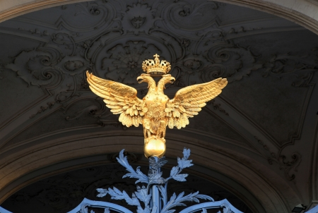 The double-headed eagle on the gates of the Winter Palace  St  Petersburg, Russia  photo
