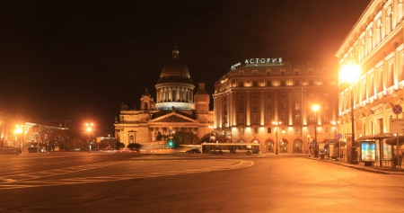 isaac s: St  Isaac s Cathedral and the hotel  Astoria  autumn night  St  Petersburg, Russia  Editorial