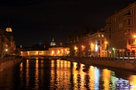 A view from the Blue Bridge on the River Sink and the dome of the Kazan Cathedral at night  St  Petersburg, Russia