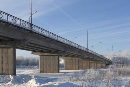 stasis: Road bridge over the river in the village of Waga Verhovazhe, Vologda Region, Russia  Stock Photo