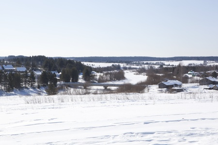 stasis: Rustic, winter landscape  Bridge over the river in the village of Waga Shelota, Verhovazhskogo District, Vologda Region, Russia