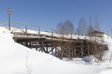 Wooden bridge to the Holy Sumorin monastery  Tot ma, Vologda Region, Russia photo