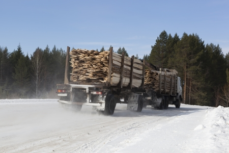 winter road: Timber-driven board on winter road