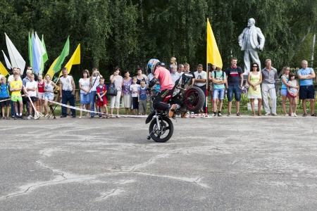 viewers: Stand on the front wheel of a motorcycle in the performance of Thomas Kalinin  Verhovazhe Vologda Region, Russia