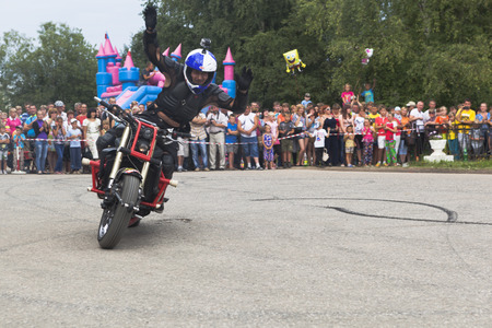 Alexei Kalinin raised his arms and welcomes visitors  Moto show in Verkhovazhye, Vologda region, Russia