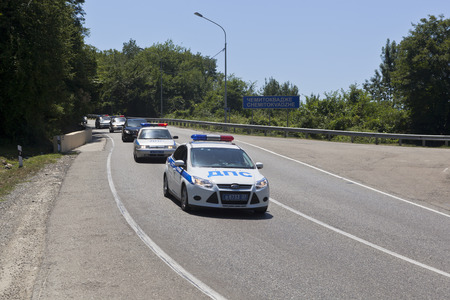 escort: Escort of police cars on road