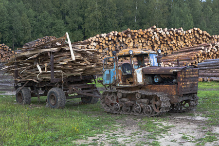 Old tractor DT-75 Kazakhstan waste removal from sawmills photo