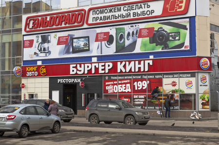 """Restaurant \""""Burger King\"""" in city of Vologda, Russia. Workers glue advertising lunch for 199 rubles"""