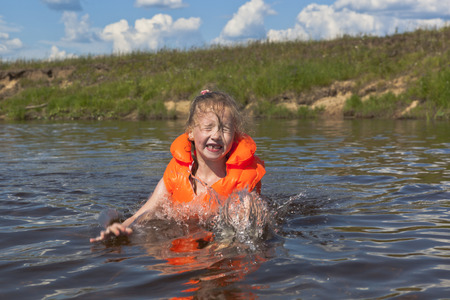 lifejacket: Little girl in inflatable lifejacket flounder about in water rivers