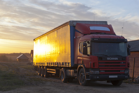 Village Street and Scania commercial vehicle in the setting sun