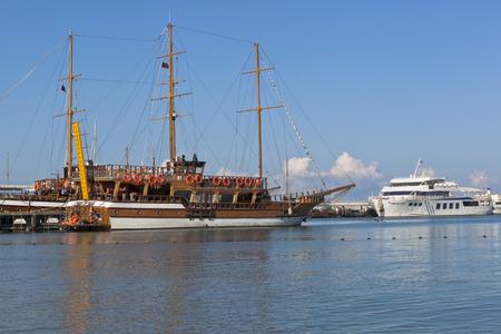 krasnodar region: Sailing Gloria and motor ship Empire at the pier in Gelendzhik Bay on a summer morning. Gelendzhik, Krasnodar region, Russia Editorial