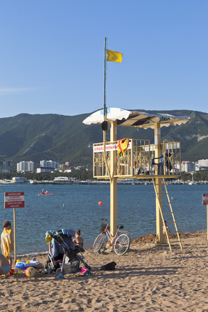 fatal: A rescue derrick and a sign saying Warning! No swimming! Danger of fatal injury on a beach in Gelendzhik
