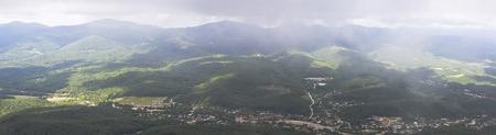 planar: View from a height on the village Aderbievka and Main Caucasian Ridge rainy summer day. Gelendzhik area, Krasnodar region, Russia Stock Photo