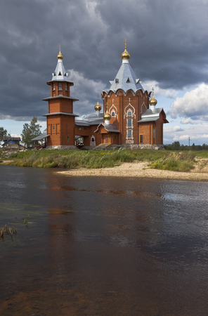 forerunner: Wooden church on the banks rivers Pezhma. Church of the Nativity of Prophet and Forerunner John the Baptist in a village Zaruchevnya Shilovskaya, Velsky district, Arkhangelsk region, Russia