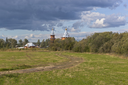 forerunner: Rural summer landscape with wooden church. Church of the Nativity Prophet and Predtechi John the Baptist in the village Zaruchevnya Shilovskaya, Velsk district, Arkhangelsk region, Russia