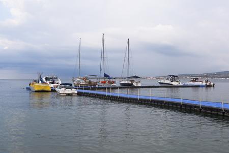 krasnodar region: Boats and yachts at the floating pier in Gelendzhik Bay early summer morning, Krasnodar Region, Russia