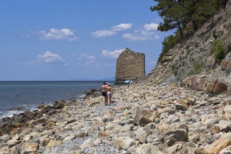krasnodar: People go along the shore of Black Sea to Sail Rock. Gelendzhik, Krasnodar region, Russia