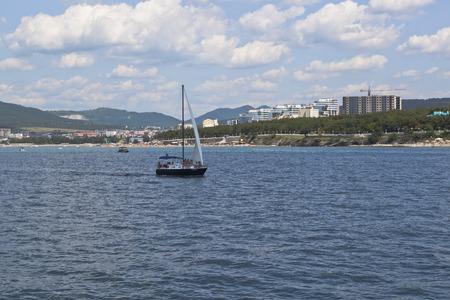 krasnodar: Sailing yacht on the water surface of Gelendzhik Bay. Gelendzhik, Krasnodar region, Russia