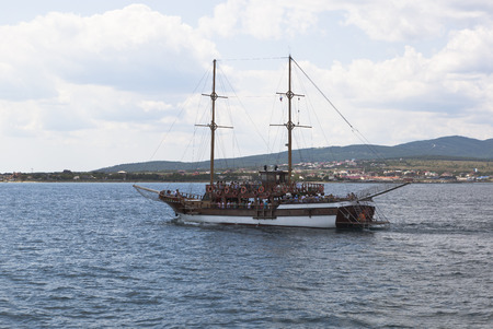 krasnodar region: Sailing ship Corsair floating on Gelendzhik Bay on background Cape Thin. Gelendzhik, Krasnodar region, Russia Editorial