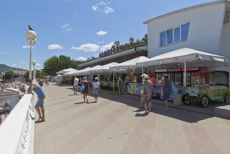 sidewalk sale: Cafe Admiral on the promenade of the resort Gelendzhik, Krasnodar region, Russia
