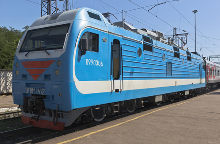 voronezh: Passenger electric locomotive EP1M-412 at the platform of the railway station of the city Voronezh, Russia