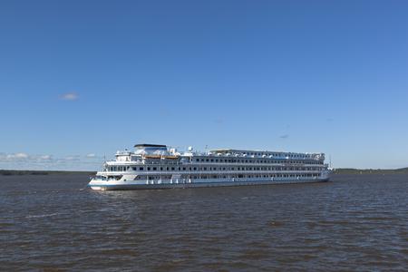 goes: Cruise ship Maxim Litvinov goes according the Sheksna River in Kirillov district, Vologda region, Russia