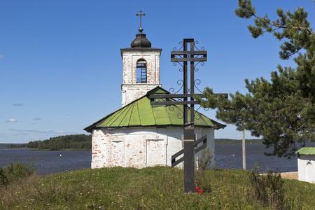 iron cross: Worship cross near Vvedensky church in the village of Gorica Vologda region, Russia Stock Photo