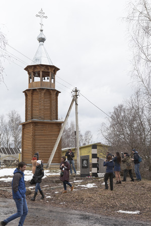 convoy: Photographers and participants of of cultural and educational project Lomonosovsky convoy. Road to the Future at the monument to Mikhail Lomonosov in the village Verkhovazhye Vologda region, Russia