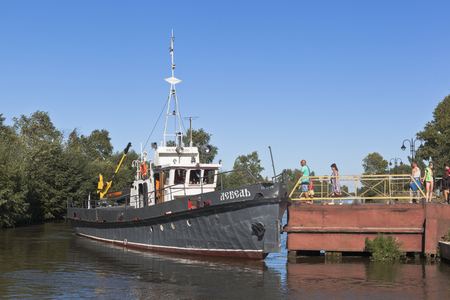 work boat: Corporate work boat Swan takes of passengers at the pier in the town of Belozersk Vologda region, Russia