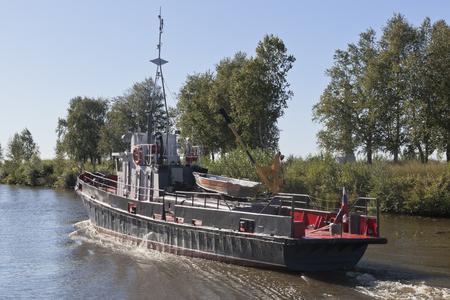 work boat: Corporate work boat Swan goes according Belozersky channel in the Vologda region, Russia
